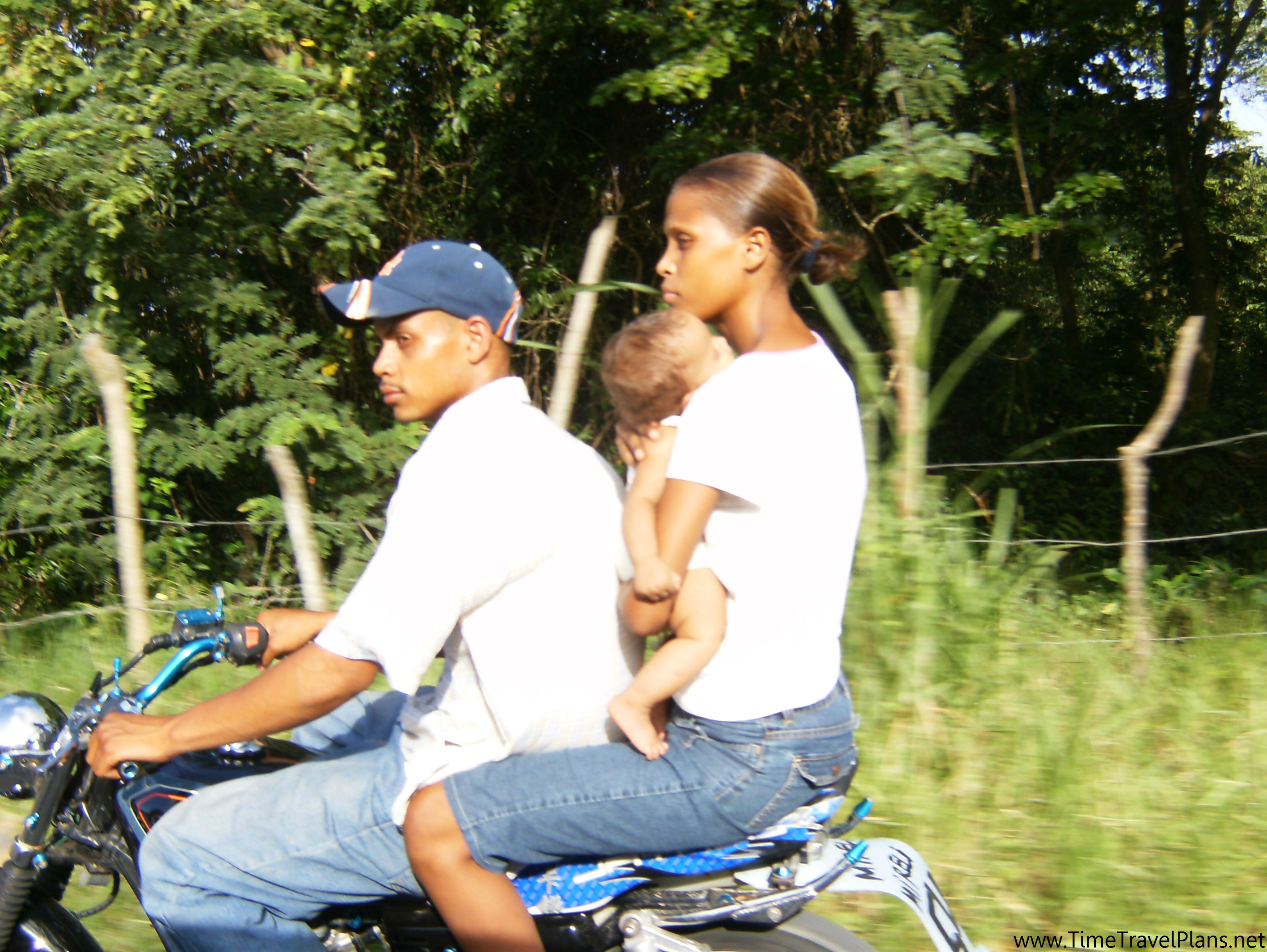 Dominican family riding on a motorcycle