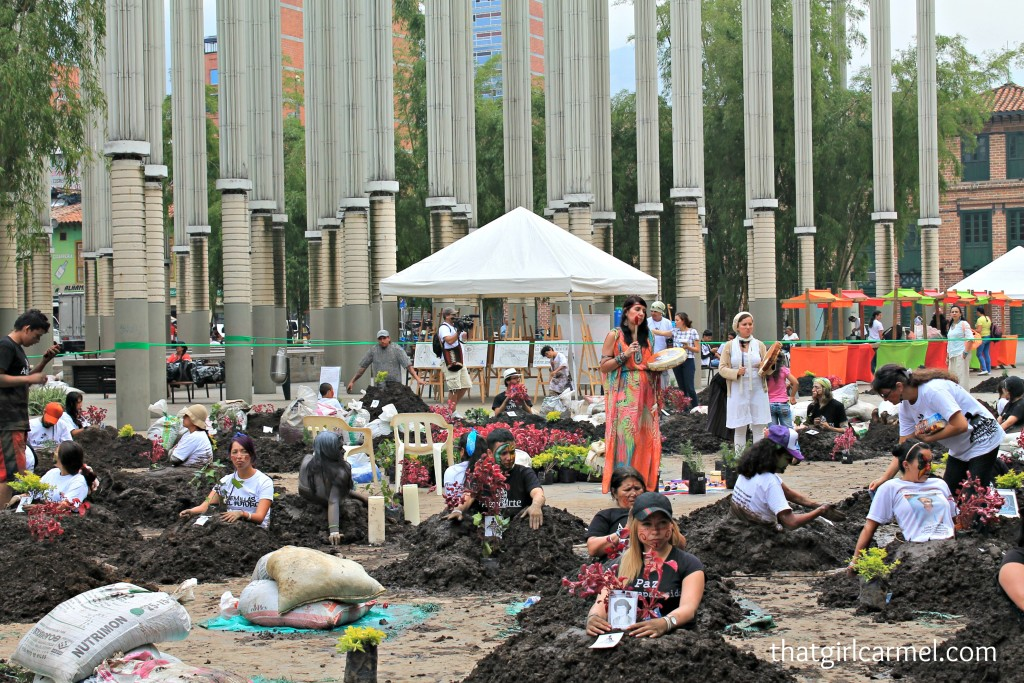 Protesters sit in mock graves to commemorate Operation Orion